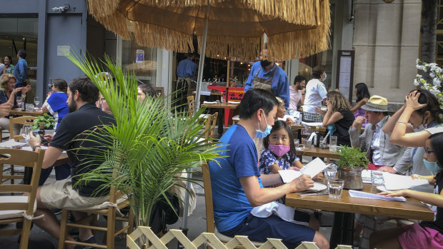 Diners eat al fresco due to COVID-19 concerns in midtown Manhattan.