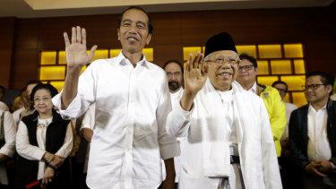 Triumphant: Indonesian President Joko Widodo, and his running mate Maruf Amin.