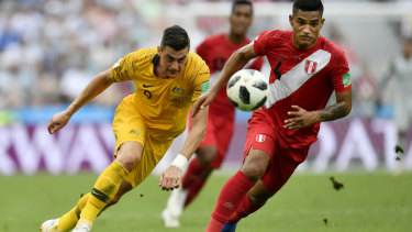 Australia just can't seem to win:  Australia's Tomi Juric, left, and Peru's Anderson Santamaria challenge for the ball.