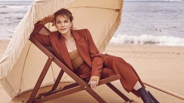 Zimmermann suit, Bottega Veneta bodysuit, Tony Bianco boots. Sunday Supply umbrella from Commune Bondi. Deckchair by Ici Et La.