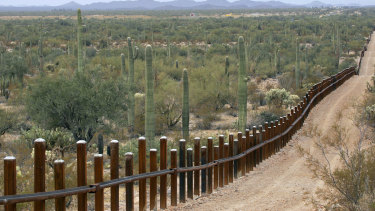 A border fence separating Mexico, left, from the US near Lukeville, Arizona.