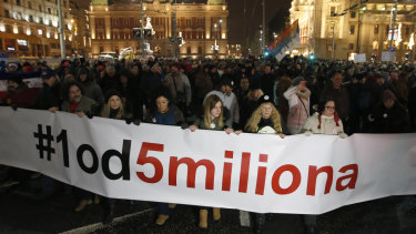 "People hold a banner that reads: ""#1 Out of 5 million"" during a protest against populist President Aleksandar Vucic in Belgrade on Saturday."