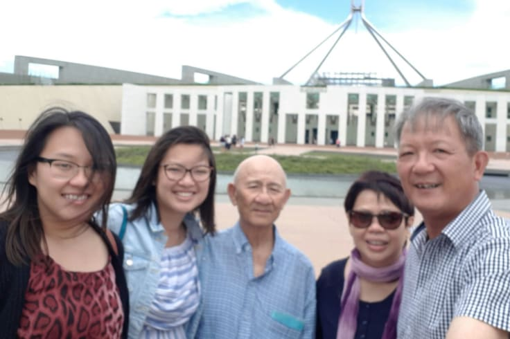 The Nguyen family, including grandpa, Hien Nguyen, visit Han in Canberra.