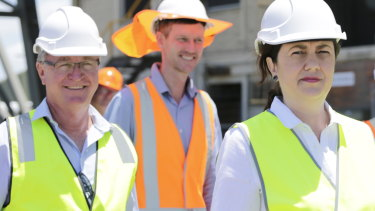 Les Walker (left) seen with Transport Minister Mark Bailey and Premier Annastacia Palaszczuk