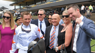 Co-trainer Adrian Bott, right, with jockey Hugh Bowman and connections after the Silver Slipper.