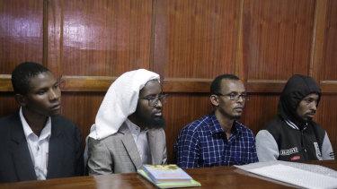From left to right, defendants Rashid Charles Mberesero, Sahal Diriye Hussein, Hassan Aden Hassan and Mohamed Abdi Abikar, sit in the dock.