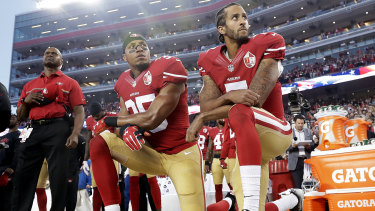 Kaepernick (right) has not played in the NFL since 2016 but his jersey remains among the league's best sellers.