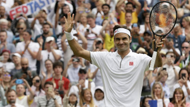 Familiar march: Federer celebrates after beating Lucas Pouile on day six at Wimbledon.