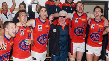 Port coach Gary Ayres sings the club song with his players after beating Footscray.