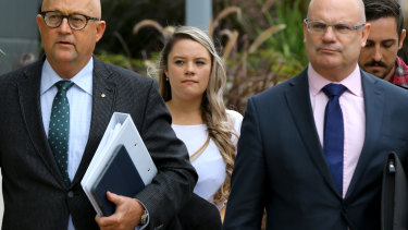 Amy Crisp (centre) arrives for the inquest into the Dreamworld disaster at the Magistrates Court at Southport.