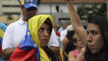 Members of the opposition gather to propose amnesty laws for police and military, in Las Mercedes neighbourhood of Caracas, Venezuela, on Saturday.