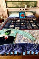Martin Sharp's bed surrounded by a mix of bourgeois china ornaments and eclectic pop art.