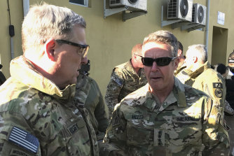 Chairman of the US Joint Chiefs of Staff General Mark Milley, left, talks with General Scott Miller, the commander of US and coalition forces in Afghanistan, Wednesday, December 16, 2020.