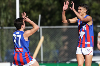 Exciting NGA prospect Jamarra Ugle-Hagan (right) is tied to the Western Bulldogs.