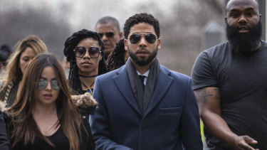 Smollett arrived at court flanked by supporters.