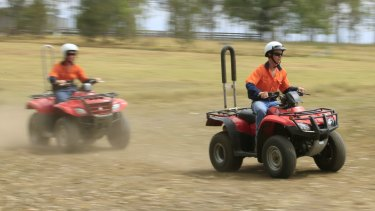School students are shown how to ride a quad bike safely.