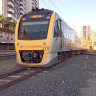 Gold Coast and Airport lines running again after grass fire causes long delays