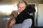 Professor Kerryn Phelps with dogs Lulu (brown) and Paris.