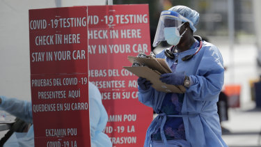 A healthcare worker at a COVID-19 testing site in South Florida