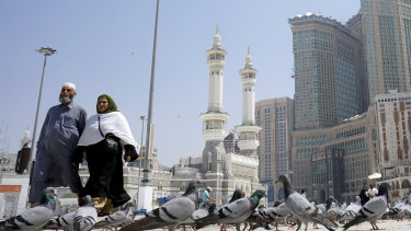 Muslim worshippers outside the Grand Mosque in the holy city of Mecca, Saudi Arabia. The kingdom has taken unprecedented measures against the spread of coronavirus, including halting pilgrimage in Mecca.