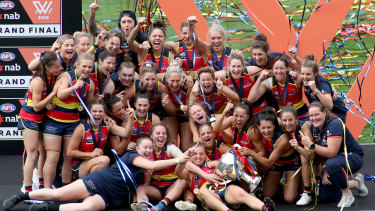 Crows' feat: Adelaide players celebrate their AFLW grand final triumph.