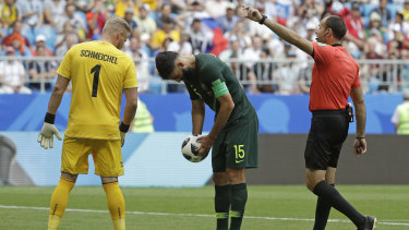 Quiet chat: Denmark goalkeeper Kasper Schmeichel tries to psych out Mile Jedinak to no avail.