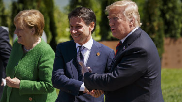 US President Donald Trump, right, shakes hands with Italian PM Giuseppe Conte at the G7 in Quebec, Canada, in June.