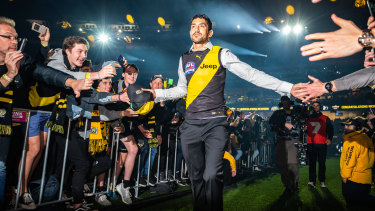 In the spotlight: New fan favourite Marlion Pickett celebrates after Richmond's flag win.