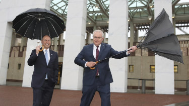 Treasurer Josh Frydenberg and Prime Minister Scott Morrison outside Parliament House.