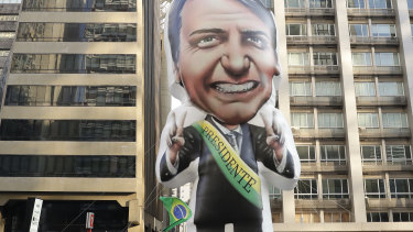 Supporters of Jair Bolsonaro, presidential candidate for the National Social Liberal Party who was stabbed during a campaign event, exhibit an inflatable doll in his image in Sao Paulo, Brazil.