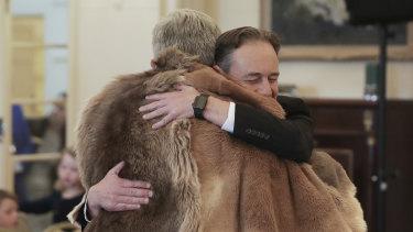 Greg Hunt embraces Ken Wyatt, sworn in this week as Minister for Indigenous Australians.