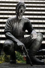 The Fawkner statue that once stood - or squatted - in Collins Street.