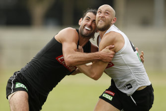 Brodie Grundy with teammate Ben Reid at Collingwood training.