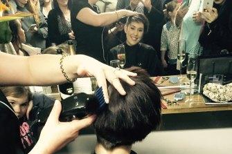 Ashlee Williams having her hair shaved off.