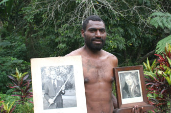 Tanna island resident Nathuan with photos of Prince Philip.
