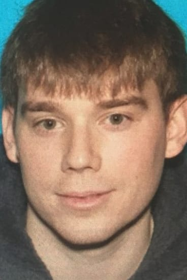 Travis Reinking, who police are searching for in connection with a fatal shooting at a Waffle House restaurant in Nashville .
