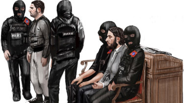 In this file courtroom sketch of February 5, 2018, Salah Abdeslam, second right, and Sofiane Ayari, second left, attend their trial at the Brussels Justice Palace.