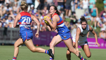 Huntington (centre) is regarded as one of the AFLW's best young players.