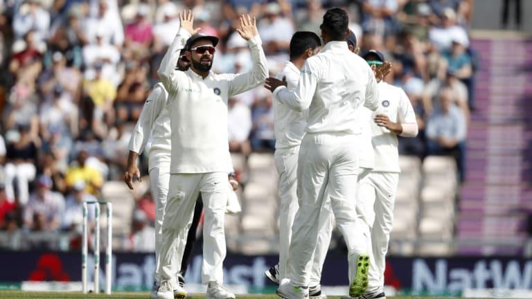 Got 'im: India's Virat Kohli (left) celebrates with teammates after Alastair Cook's dismissal.