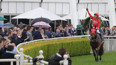 Jockey Kerrin McEvoy returns to scale after riding Redzel to victory in The Everest.