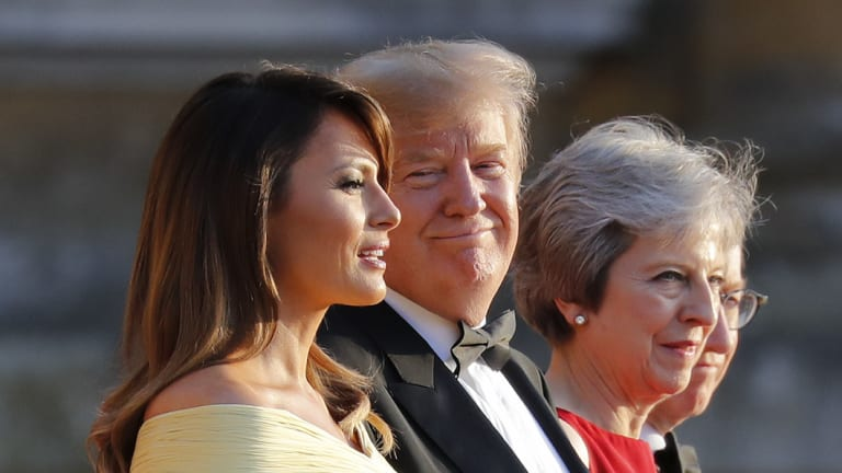 US President Donald Trump with his wife Melania and British Prime Minister Theresa May at Blenheim Palace.