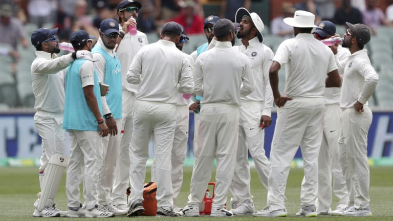 Upbeat: India enjoy a drinks break at Adelaide Oval on Friday.