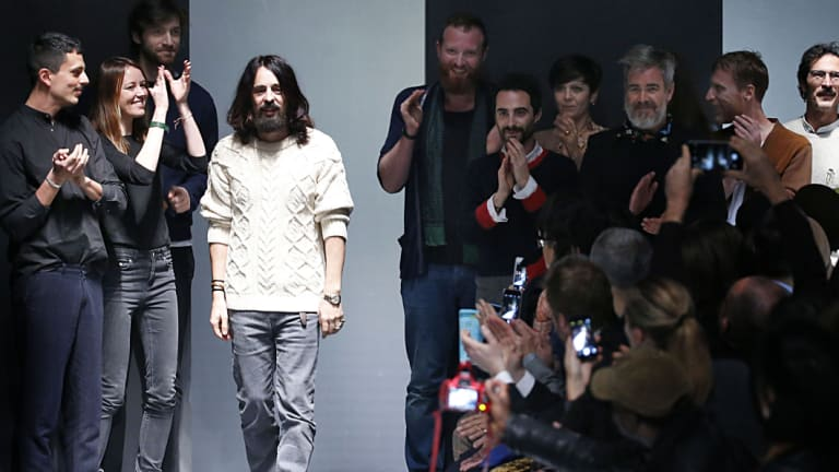 Alessandro Michele with his team on the runway after his first Gucci show.