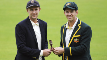 England captain Joe Root, left, and Australia's captain Tim Paine pose with the Ashes urn before the first Ashes Test match between England and Australia at Edgbaston.