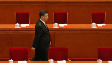 Xi Jinping arrives at the podium to speak of the relevance of Marxism in modern China.