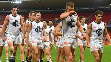 Carlton trudge off Giants Stadium after their latest humiliation on Sunday.