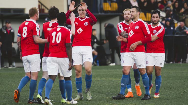 Canberra FC celebrate Matthew Waters' opening goal.