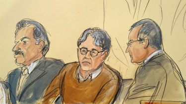 Defendant Keith Raniere, centre, is seated between his attorneys Paul DerOhannesian, left, and Marc Agnifilo during the first day of his sex trafficking trial.