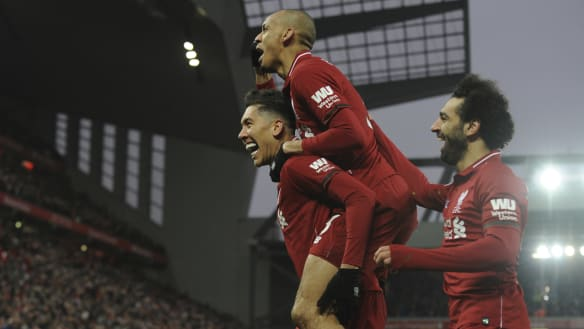 Soaring: Liverpool survived a thriller to stretch their lead over dormant Manchester City to seven points.