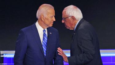 Democratic presidential candidates Senator Bernie Sanders and former vice-president Joe Biden during a break in the Democratic primary debate.